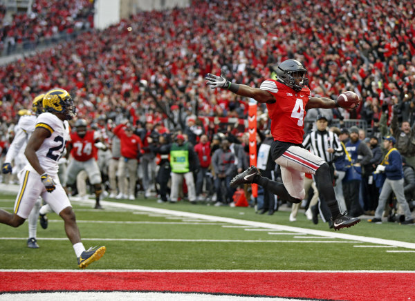 Ohio State Buckeyes running back Curtis Samuel (4) jumps into a the end zone for the game winning touchdown in a double overtime win over Michigan Wolverines touchdown at Ohio Stadium in Columbus, Ohio on November 26, 2016. (Kyle Robertson / The Columbus Dispatch)