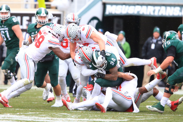 Tyquan Lewis (59), Sam Hubbard (6) and the swarming Silver Bullets!